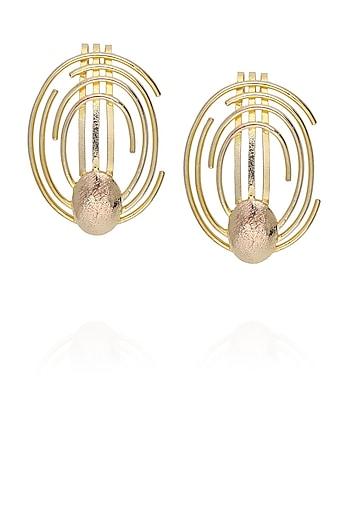 Gold plated concentric earcuff by Malvika Vaswani