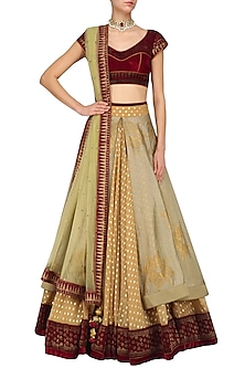 Maroon and gold aari work lehenga set by Mynah Designs By Reynu Tandon