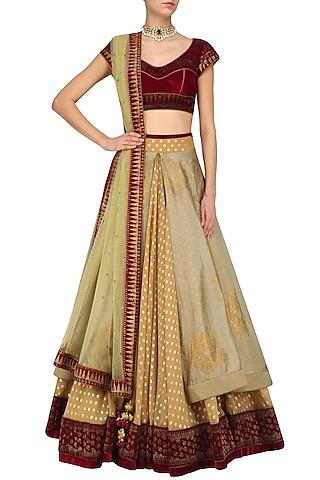 Maroon and gold aari work lehenga set by Mynah Designs By Reynu Tandon