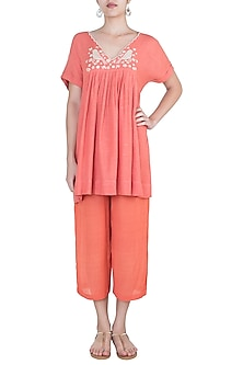 Carrot embroidered pleated tunic by Myoho