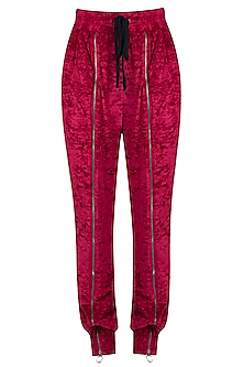Red velvet track pants by MYRIAD