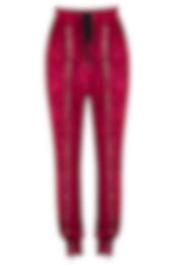 Red velvet track pants by MYRIAD