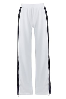 White embroidered wide leg pants by MYRIAD
