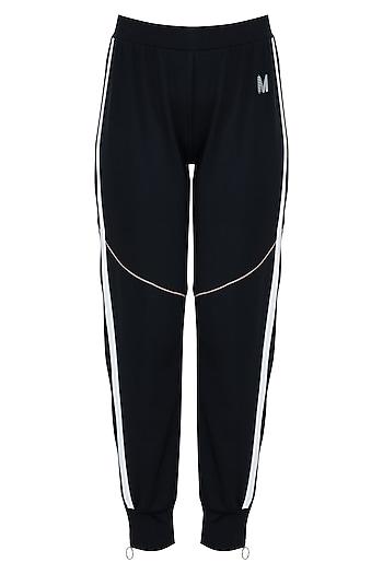 Black track pants by MYRIAD