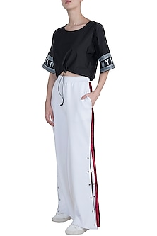 White wide cut pants by MYRIAD