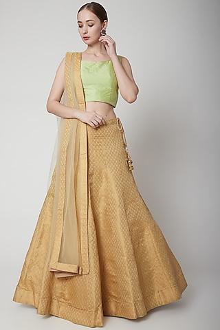 Gold & Green Brocade Lehenga Set by NARMADESHWARI