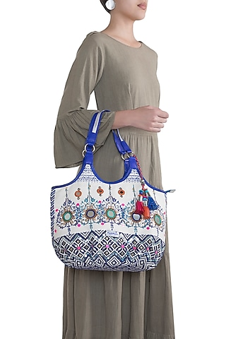 White & Blue Handblock Printed Embroidered Tasseled Hobo Bag by Neonia