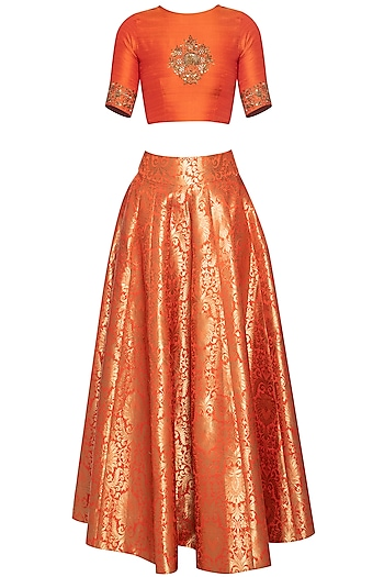 Orange embroidered crop top with lehenga skirt by Ranian