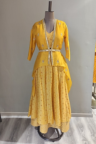 Mustard Printed & Embroidered Skirt Set With Cape & Belt by Ne'Chi