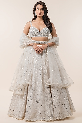 Ivory Sequins Embroidered Lehenga Set by NITIKA GUJRAL