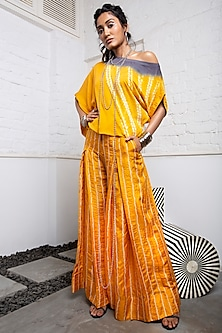 Mustard Bandhani Box Pleated Pants With Dyed Top by Nupur Kanoi