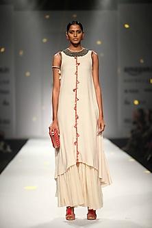 Ivory Asymmetric Embroidered Tassel Hanging Kurta with Matching Gathered Skirt by Nikasha