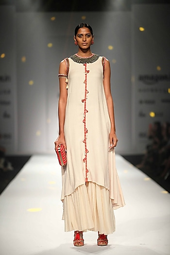 Ivory Asymmetric Embroidered Tassel Hanging Kurta with Matching Gathered Skirt by Nikasha