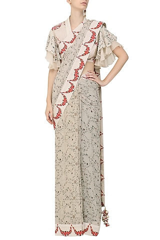 Ivory Hand Painted and Embroidered Saree with Ruffled Blouse by Nikasha