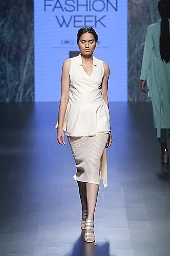 Peach asymmetric wrap top and knit mesh long shirt by Nishka Lulla