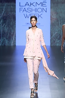 Pink beaded flower peplum top and tapered pants by Nishka Lulla