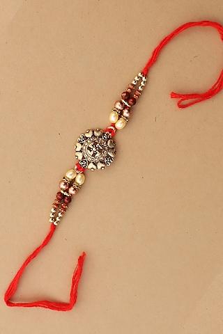 Red Beaded Swastik Rakhi by Namasya