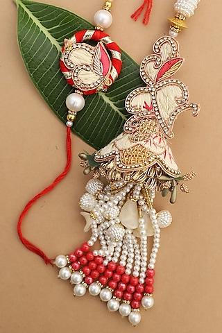 Pink & White Floral bhaiya-Bhabhi Rakhi Set by Namasya