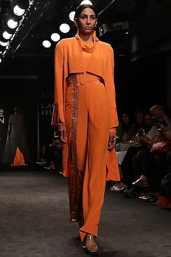 Tangerine High Low Coat with Turtle Neck Body Suit and Bell Bottom Pants by Nikita Mhaisalkar