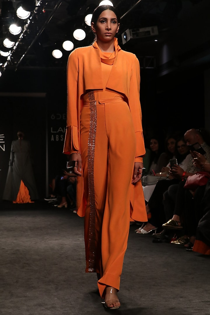 Tangerine High Low Coat with Turtle Neck Body Suit and Bell Bottom Pants by NITIKA GUJRAL