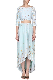 Powder blue embroidered crop top and asymmetric skirt by Nautanky By Nilesh Parashar