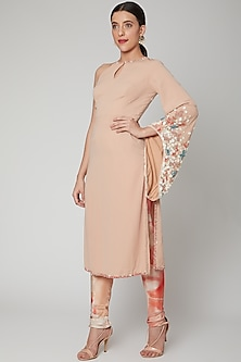 Salmon Pink Embroidered Kurta With Trousers by Nirmooha