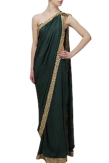 Green and gold embroidered saree by Nikhil Thampi