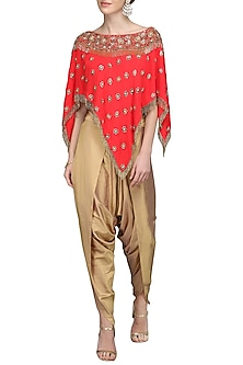 Tomato Red Embroidered Cape Top with Gold Dhoti Pants by Nandita Thirani