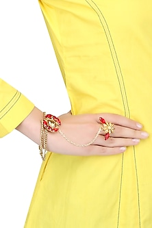 Gold plated double layered hand harness with red and gold stones by Ornamas By Ojasvita Mahendru