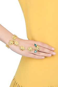 Gold plated floral motifs hand harness with green stones by Ornamas By Ojasvita Mahendru