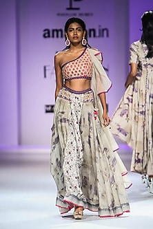 Beige One Shoulder Embroidered Crop Top with Digital Floral Print Skirt by Poonam Dubey Designs