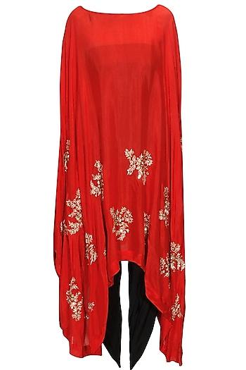 Red motifs cape with dhoti pants by Prathyusha Garimella