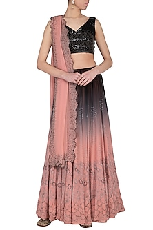 Black and pink ombre embroidered lehenga set by POULI