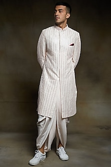 Cream Embroidered Sherwani Set by Pink Peacock Couture Men