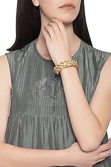 Gold plated 3 line kundan and zari bracelet by Parure