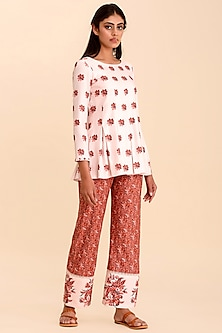 Pink Printed Top With Red Pants by Pasha