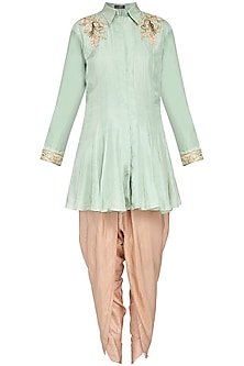 Pista green kurta with beige dhoti pants set by Priyanka Singh
