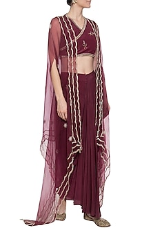 Maroon crop top with drape skirt and cape by PRIYANKA SINGH