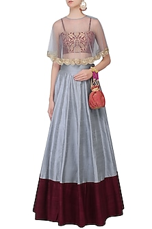 Powder Blue and Pomegranate Color Blocked Lehenga Set With Bustier and Cape by Payal Singhal