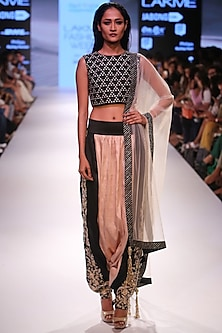 Black embroidered crop top with blush and black low crotch embellished dhoti pants by Payal Singhal