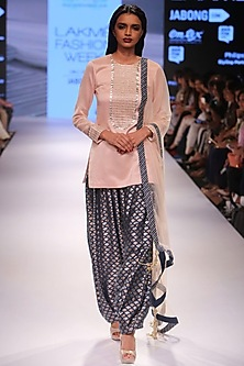 Blush embroidered short kurta with navy fish scale Afghani salwar and blush dupatta. by Payal Singhal