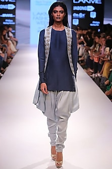 Navy short kurta with powder blue embroidered jacket and cowl pants. by Payal Singhal