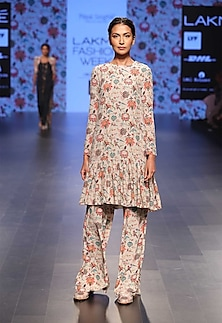 Khaki coloured long embroidered kurta with printed palazzo pants by Payal Singhal