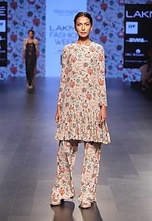 Khaki coloured long embroidered kurta with printed palazzo pants by Payal Singhal