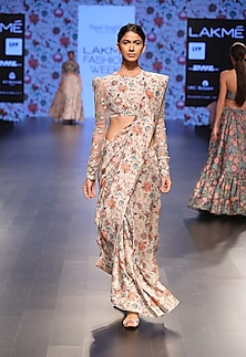 Khaki colored saree with printed floral embroidered choli by Payal Singhal