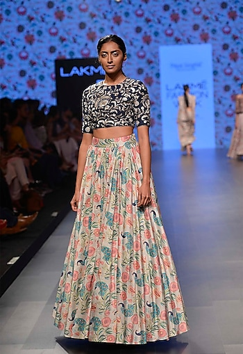 Navy blue dupion silk blouse with khaki color flared skirt by Payal Singhal