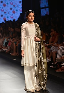 Ivory short pleated kurta with ivory palazzo pants and green embroidered dupatta by Payal Singhal