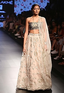 Stone colour hibiscus embroidered lehenga and navy bustier set by Payal Singhal