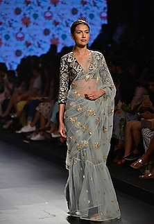 Powder blue saree with navy blue floral applique blouse by Payal Singhal