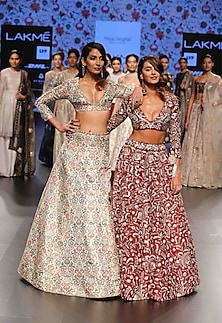 Pomergranate color blouse with pomergranate flared embroidered lehenga by Payal Singhal